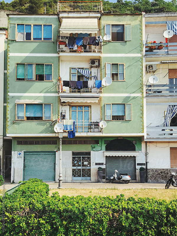 Italy - Green Apartment Block With Laundry Hanging on Balcony by Julien L. Balmer for Stocksy United