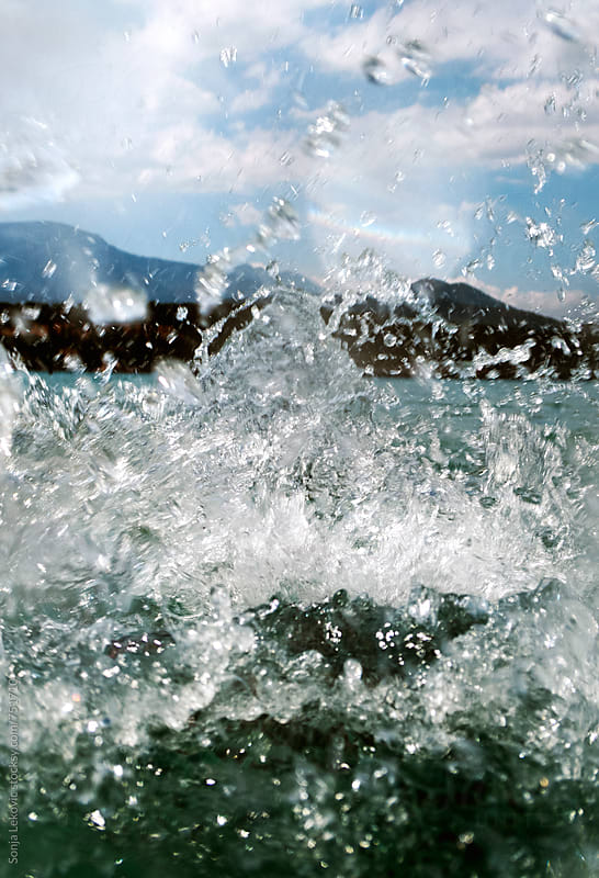 sea water splash and blue sky closeup by Sonja Lekovic for Stocksy United