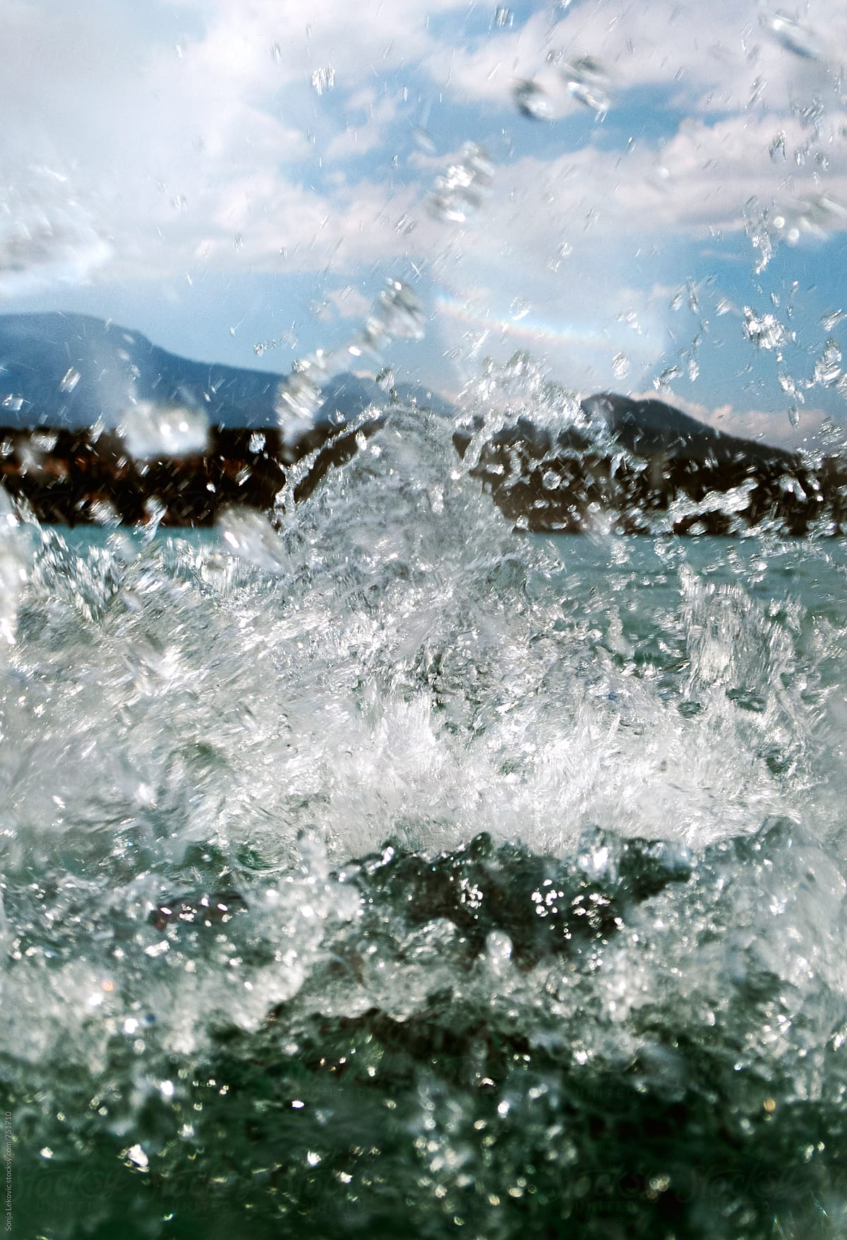 3a57f6dd6392c3 Sea Water Splash And Blue Sky Closeup