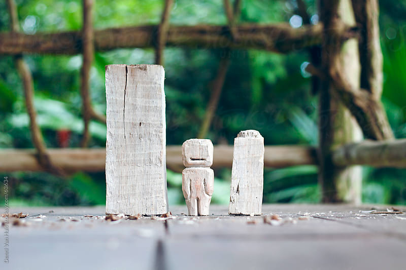 Wooden doll handcrafted out of balsa wood by Denni Van Huis for Stocksy United
