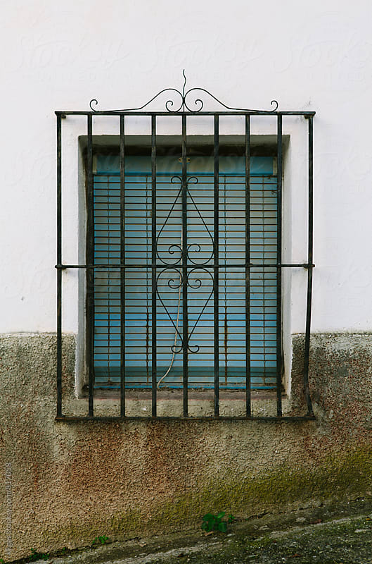 Window with shutters and security bars by kkgas for Stocksy United
