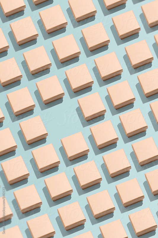 Rows Of Tiny Boxes Missing One Box by Sean Locke for Stocksy United
