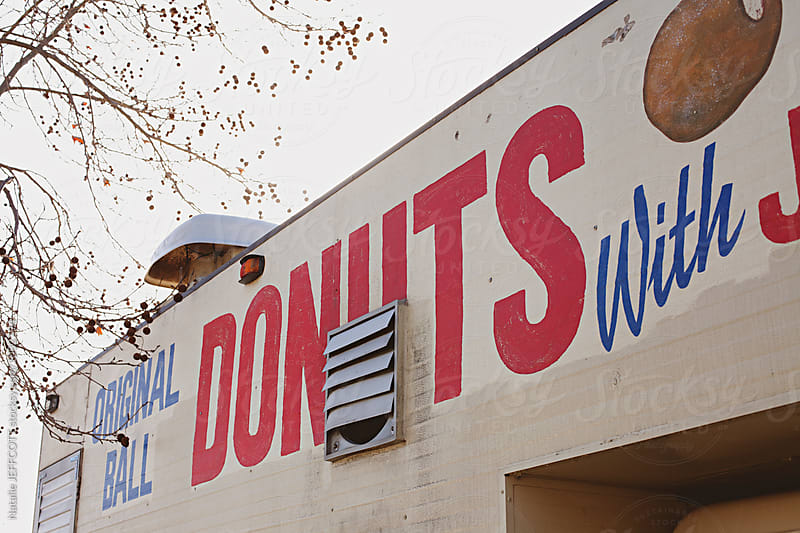 retro food van signage selling donuts by Natalie JEFFCOTT for Stocksy United