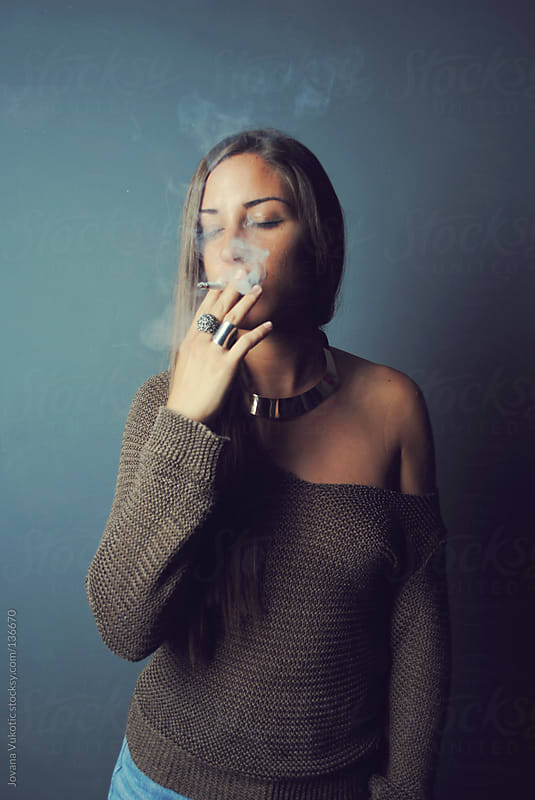 girl smoking by Jovana Vukotic for Stocksy United