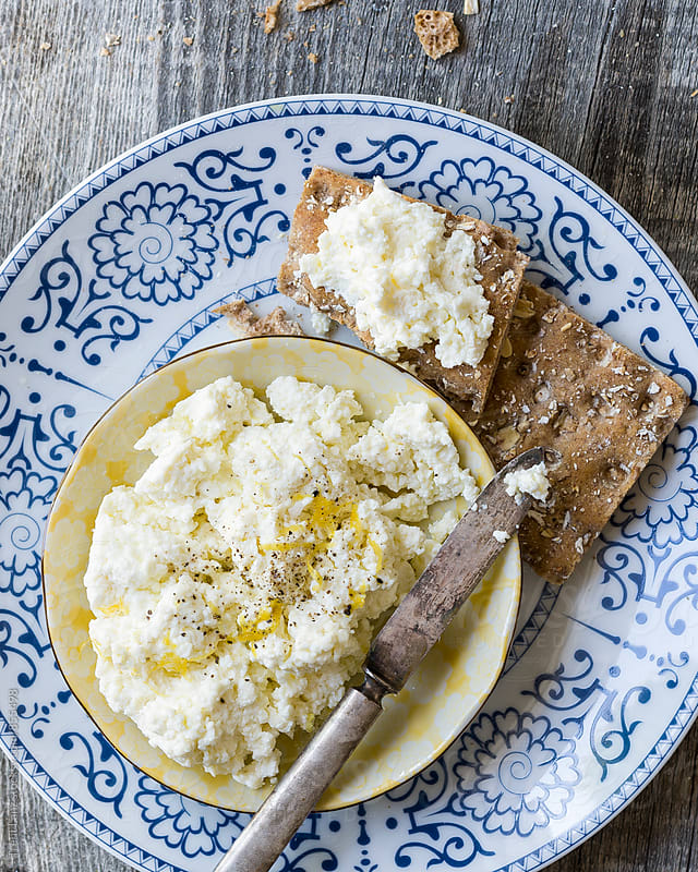 Close-up of homemade ricotta cheese and toasts by Trent Lanz for Stocksy United