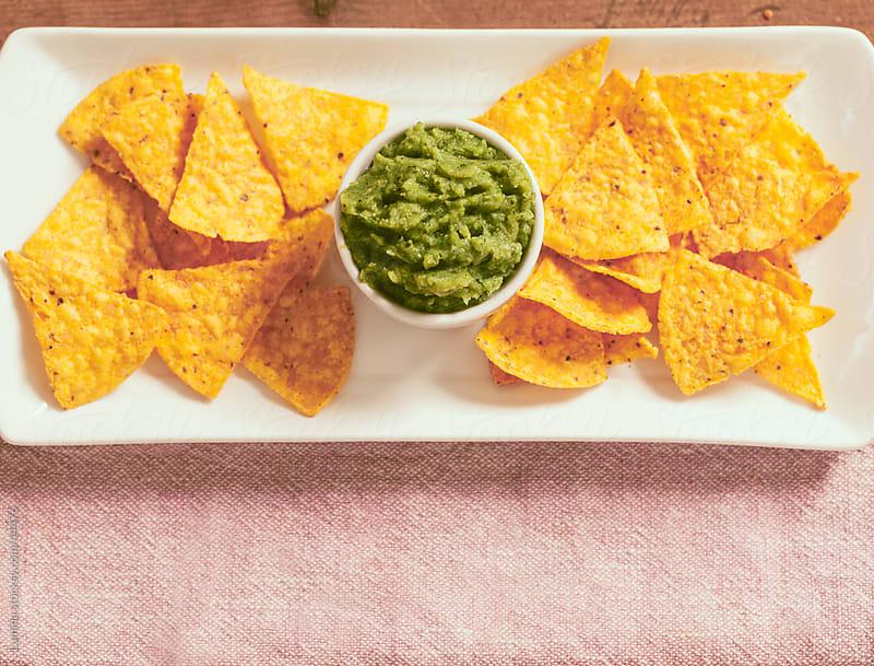 Nachos and Guacamole Salsa by Lumina for Stocksy United