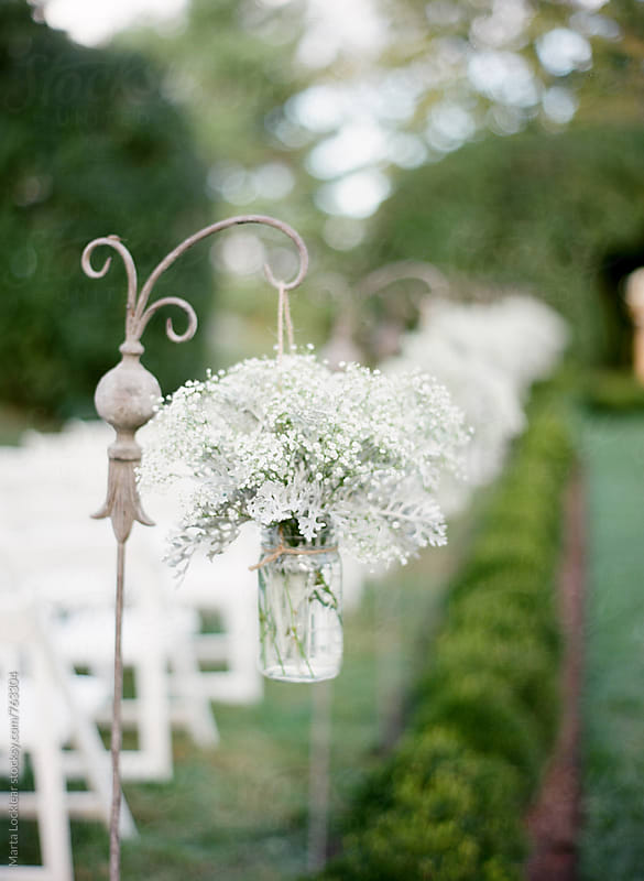 Baby's breath lined ceremony path by Marta Locklear for Stocksy United
