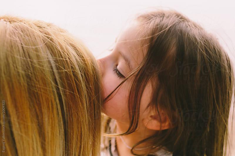 Little girl embracing her mother by Evgenij Yulkin for Stocksy United