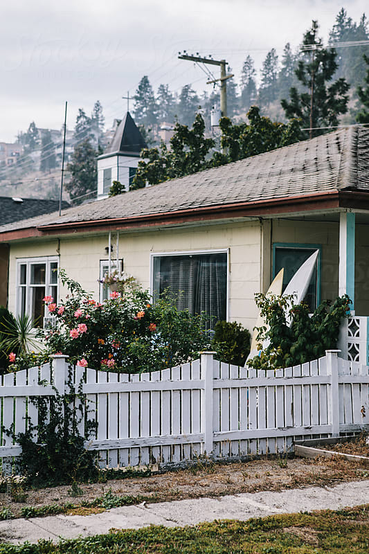 Quaint cottage with surf boards and picket fence by kkgas for Stocksy United