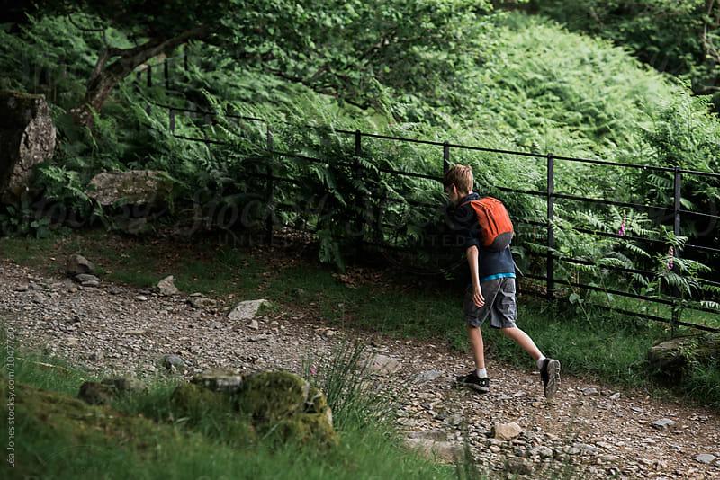 boy walking on a path by Léa Jones for Stocksy United