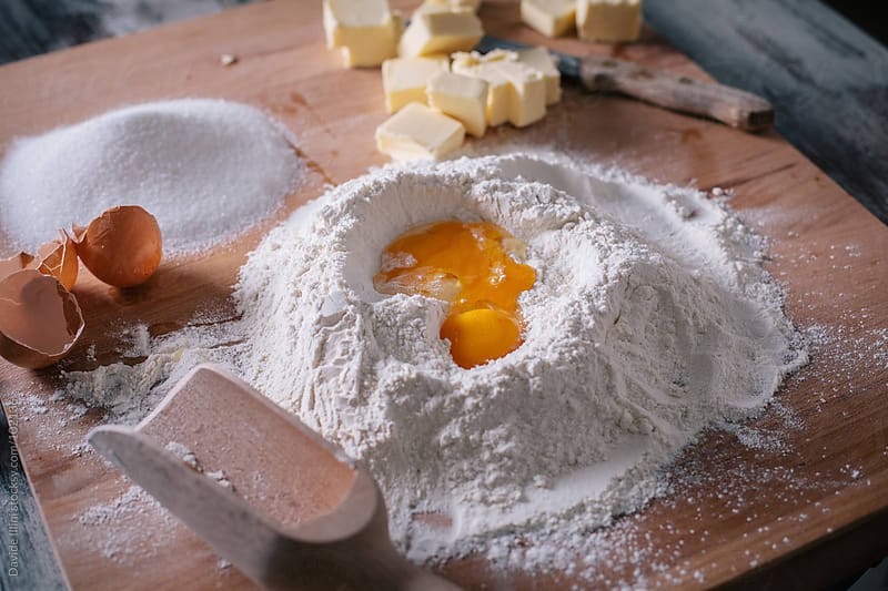 Preparing Dough. Mixed ingredients on wooden table. by Davide Illini for Stocksy United