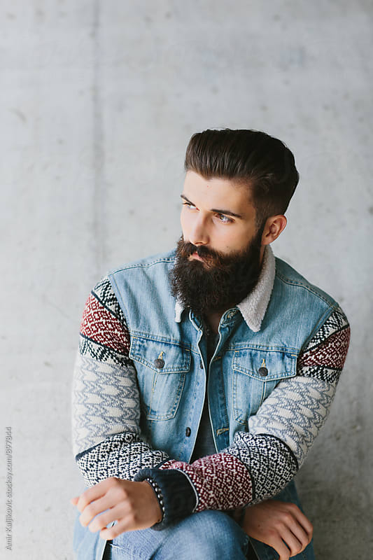 Handsome trendy bearded young man by Amir Kaljikovic for Stocksy United
