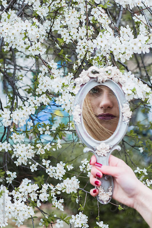 Girl's reflection in a mirror by Jovana Rikalo for Stocksy United