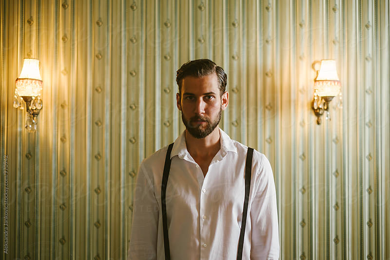 Portrait of a Handsome Young Man in Front of the Vintage Wallpaper by Aleksandra Jankovic for Stocksy United
