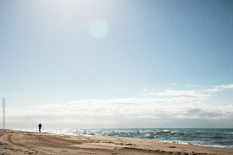Man running on the beach. by BONNINSTUDIO for Stocksy United
