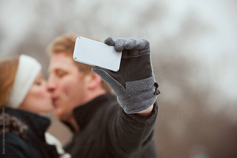 Skating: Couple Sharing A Kiss For A Selfie by Sean Locke for Stocksy United