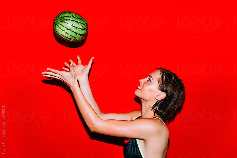 Playing with a Watermelon. Throw and Catch  by Studio Firma for Stocksy United