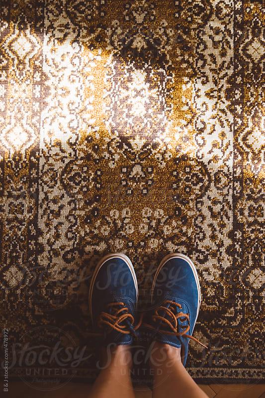 Sunlight over the carpet by B & J for Stocksy United