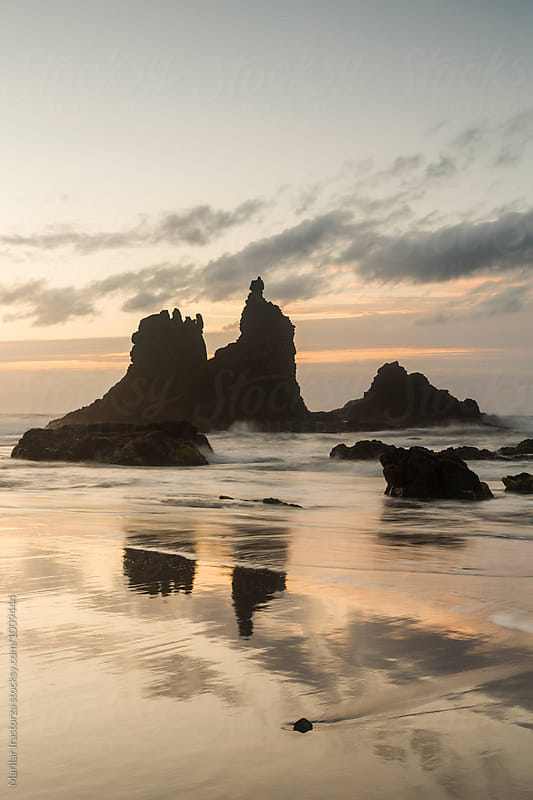 Rocky and volcanic beach at sunset by Marilar Irastorza for Stocksy United