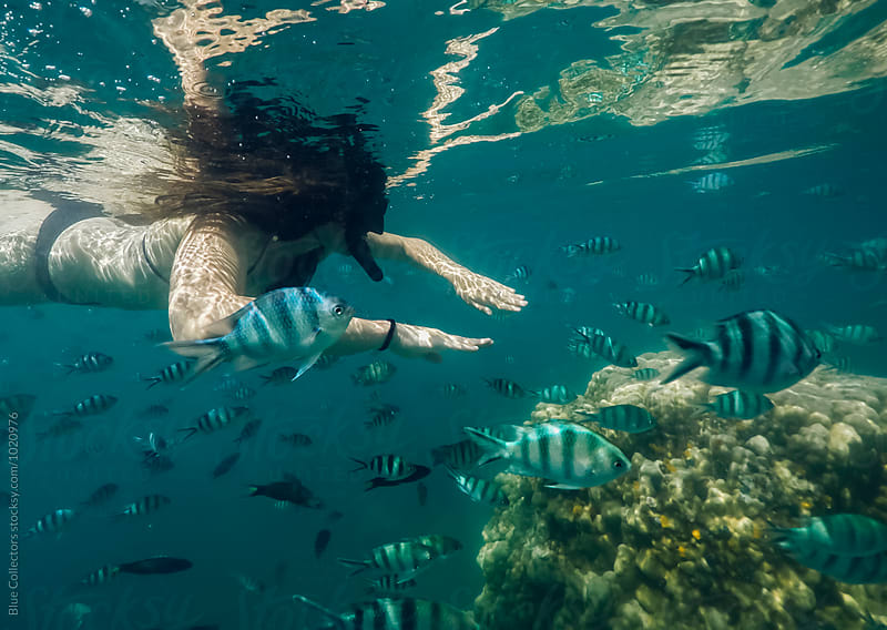 Woman snorkeling by Jordi Rulló for Stocksy United