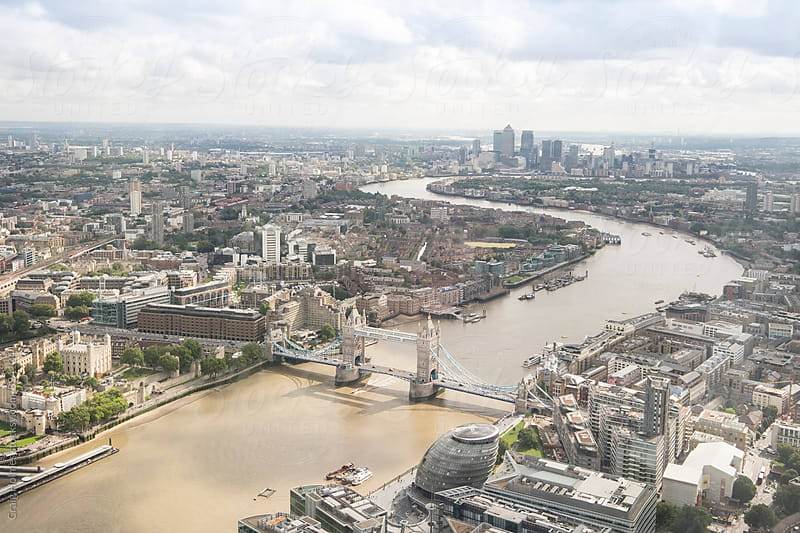 An aerial view of the city of London, England, overlooking Tower Bridge. by Craig Holmes for Stocksy United