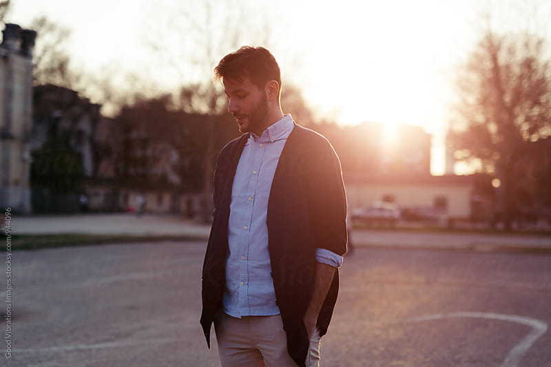 Pensive man portrait at sunset by Good Vibrations Images for Stocksy United