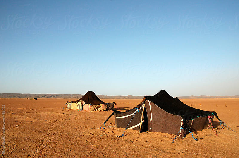 Arabic tents in the desert by Bisual Studio for Stocksy United