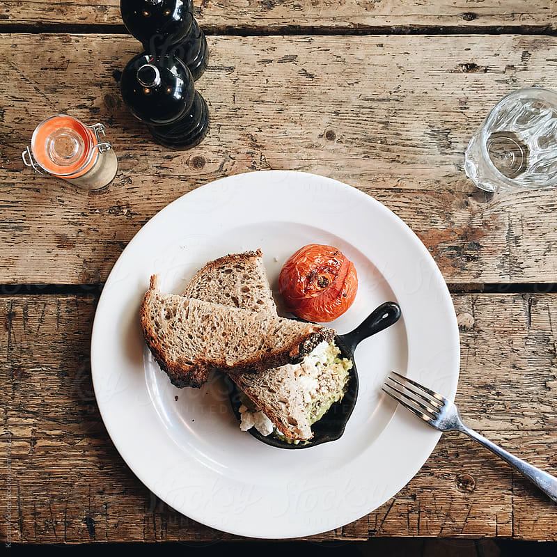 Breakfast of toast and roast tomato by Kirstin Mckee for Stocksy United