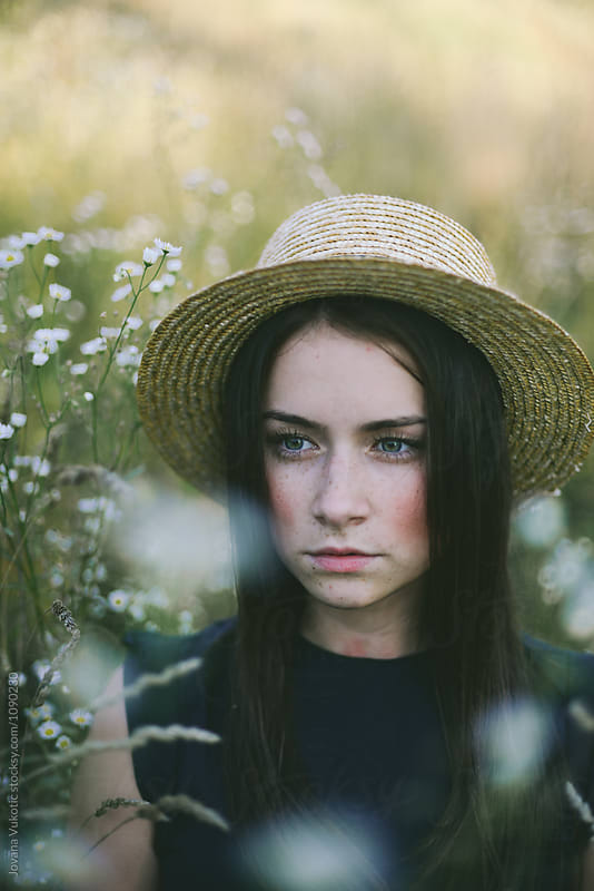 young woman with a hat by Jovana Vukotic for Stocksy United