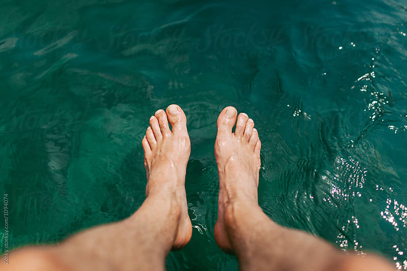 Feet of a man enjoying the sea by Zocky for Stocksy United
