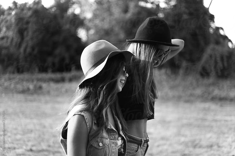Two stylish female friends laughing. Black and white.  by Marija Mandic for Stocksy United