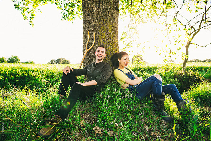 Farmer couple relaxing in the nature at afternoon. by BONNINSTUDIO for Stocksy United