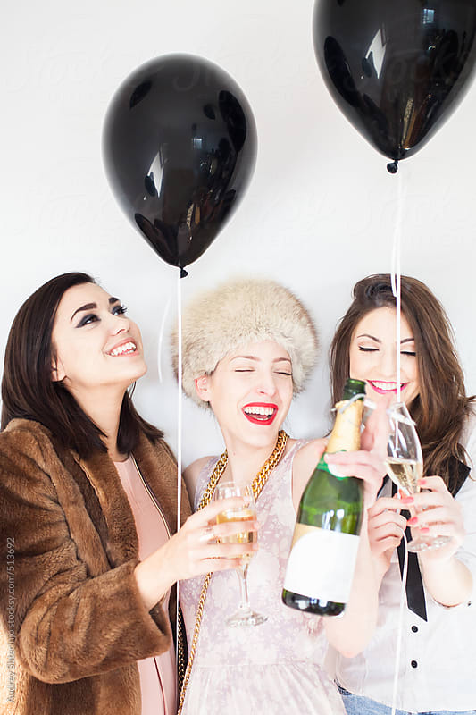 Three stylish women having a party time. by Audrey Shtecinjo for Stocksy United