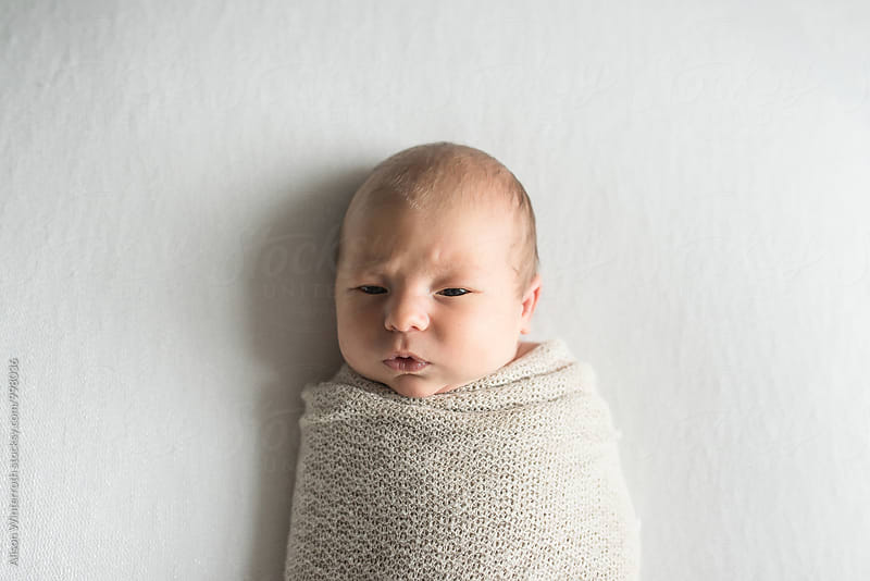 Baby Making A Funny Face by Alison Winterroth for Stocksy United