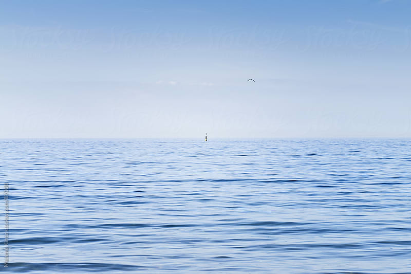 Calm blue sea, minimalist composition by Melanie Kintz for Stocksy United