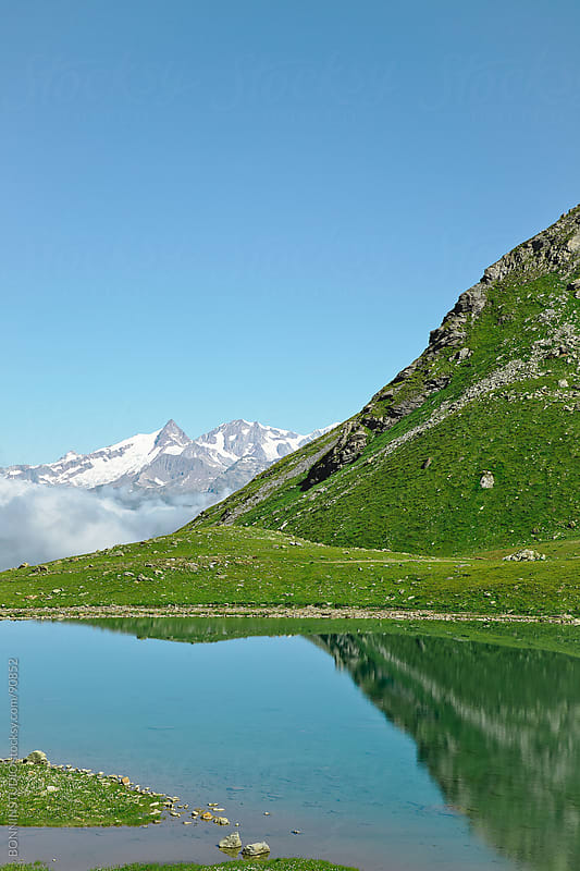 Beautiful lake reflex landscape. Alps, France. by BONNINSTUDIO for Stocksy United