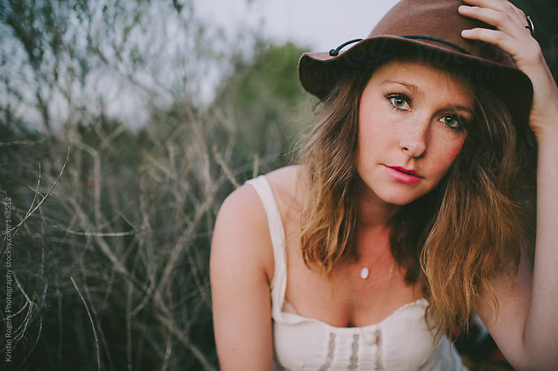 Portrait of pretty stylish woman wearing hat by Kristin Rogers Photography for Stocksy United