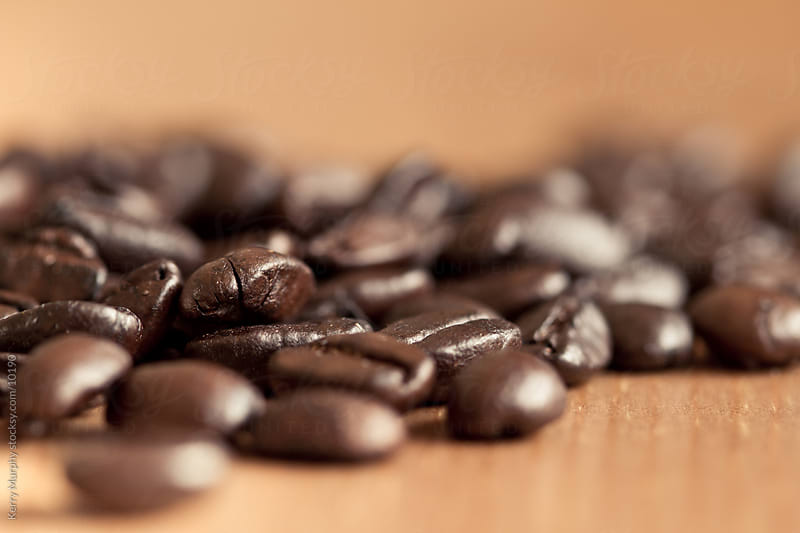 Macro of whole coffee beans by Kerry Murphy for Stocksy United
