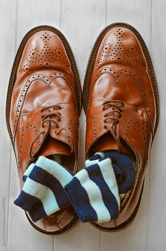 Scruffy brogues and stripey socks. by Darren Muir for Stocksy United