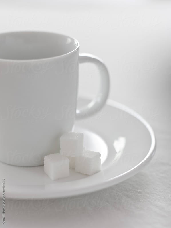 Coffee and sugar cubes by Daniel Hurst for Stocksy United