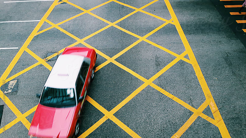 Red Taxi in Hong Kong by Carlo Amoruso for Stocksy United
