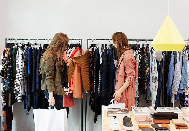 Friends shopping for clothes in a boutique. by W2 Photography for Stocksy United