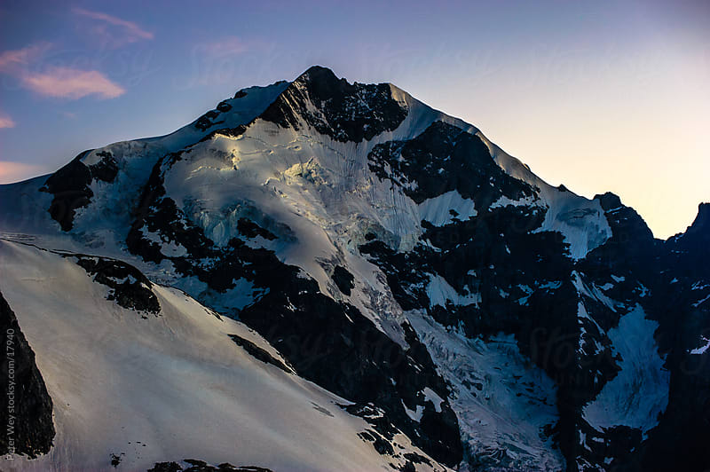 Mountains of Switzerland: Piz Bernina at dusk by Peter Wey for Stocksy United