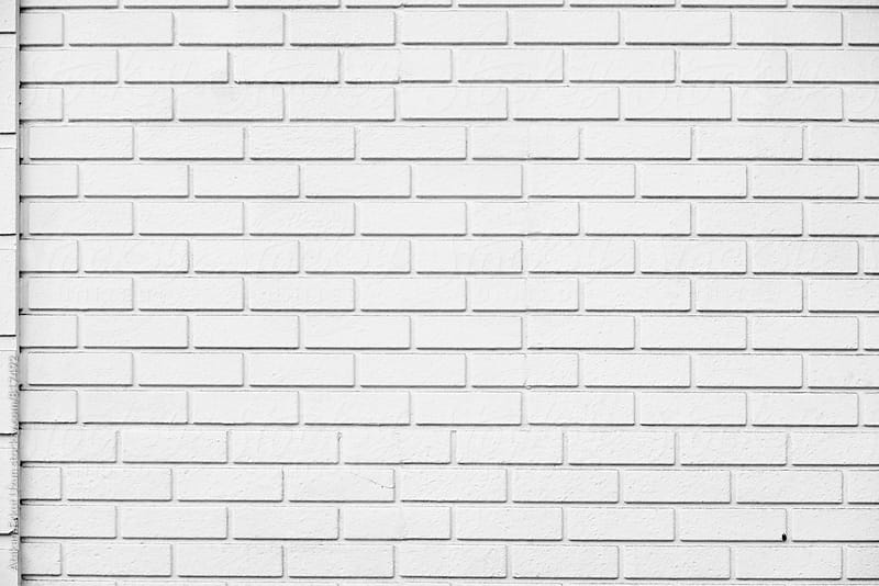 white brick wall by Atakan-Erkut Uzun for Stocksy United