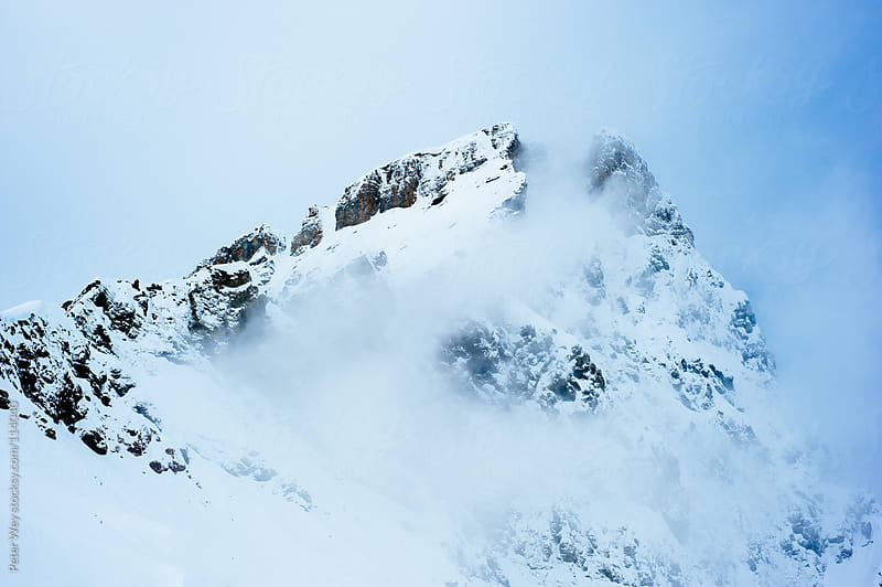 foggy mountain ridge by Peter Wey for Stocksy United