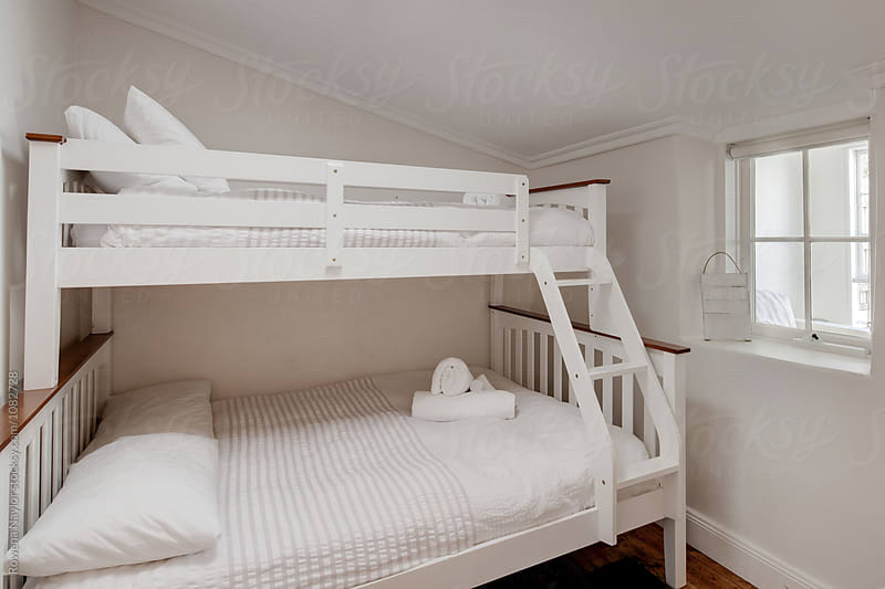 Bunk beds in kids room by Rowena Naylor for Stocksy United