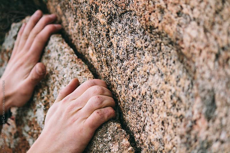 Close up of hands rock climbing by Alejandro Moreno de Carlos for Stocksy United