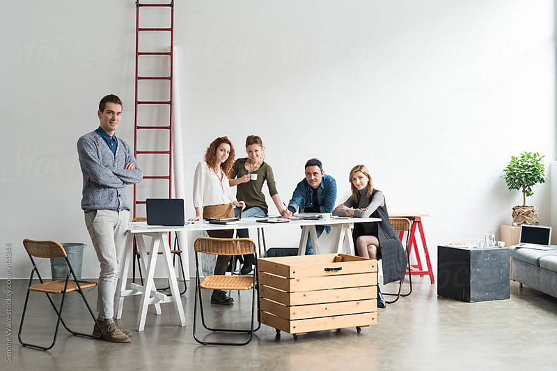 Young teamwork portrait in modern office by GIC for Stocksy United