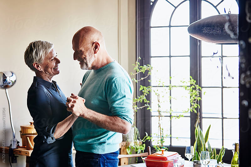 Romantic Senior Couple Dancing At Home by ALTO IMAGES for Stocksy United