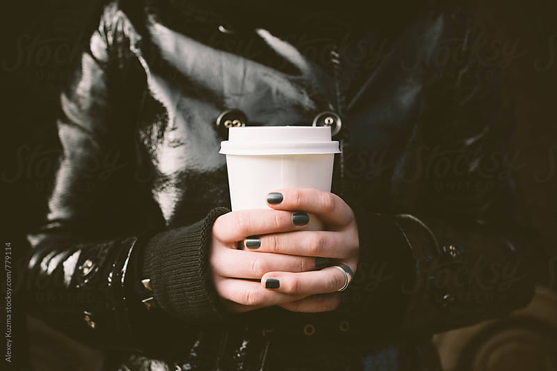 hands of young woman with coffee by Alexey Kuzma for Stocksy United